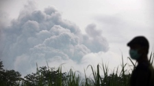 Mount Kelud erupts wide shot in Indonesia