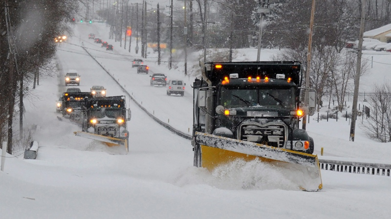A plow train heads south on Route 202 between Dilworthtown Road and Route 1 in Birmingham Township on Thursday, Feb. 13, 2014. (AP Photo/Philadelphia Inquirer, Clem Murray)
