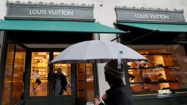 A pedestrian walks past a Louis Vuitton store in downtown Vancouver, B.C., on March 8, 2011. (Jonathan Hayward / THE CANADIAN PRESS)
