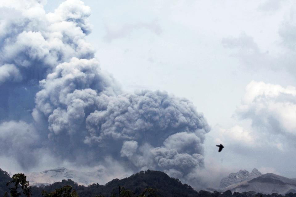 Mount Kelud erupts, as seen from Anyar village in Blitar, East Java, Indonesia, Friday, Feb. 14, 2014. (AP / Trisnadi)