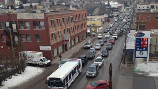 It's bumper-to-bumper traffic on many streets heading into the core on February 14, 2014, after police have shut down several routes due to a homicide investigation.