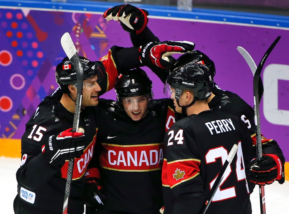 Team Canada celebrates a first period goal against Austria during a men's ice hockey game at the 2014 Winter Olympics, Friday, Feb. 14, 2014, in Sochi, Russia. (AP  / Julio Cortez)
