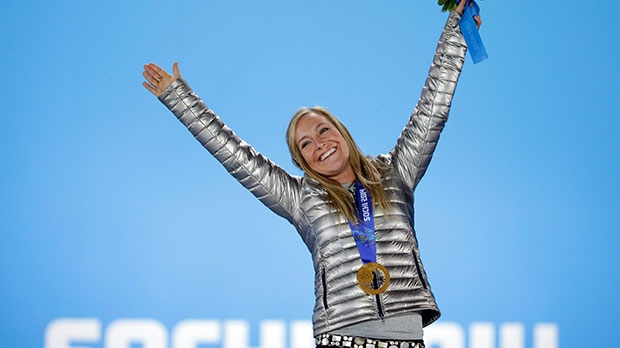 Women's snowboard slopestyle gold medalist Jamie Anderson of the United States stands on the podium during the medals ceremony at the 2014 Winter Olympics in Sochi, Russia, Sunday, Feb. 9, 2014. (AP / David Goldman)
