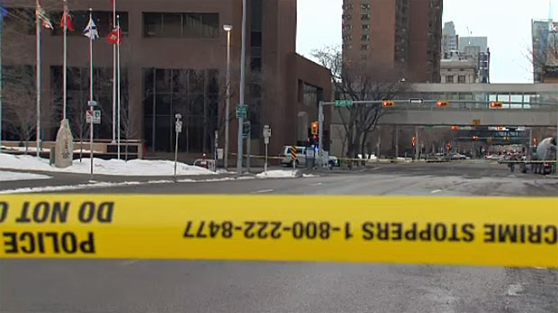Police cordoned off several blocks to investigate the stabbing death of a man on Friday, February 14, 2014.