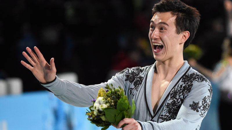 Men's silver medalist Canada's Patrick Chan reacts to the crowd during flower ceremonies in the figure skating competition at the Sochi Winter Olympics in Sochi, Friday, Feb. 14, 2014. (Paul Chiasson / THE CANADIAN PRESS)
