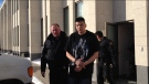 Joshua Bird is seen leaving Court of Queen's Bench in Regina on Friday, Feb. 14, 2014.