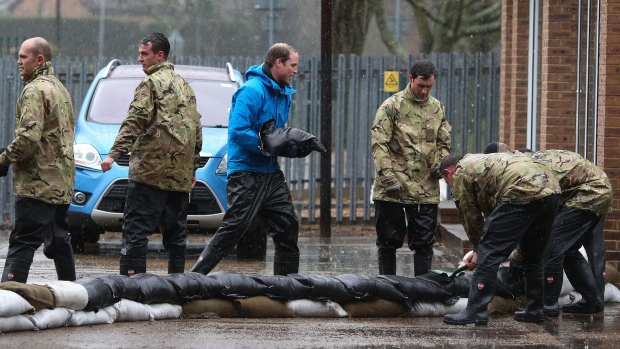 Prince William, Harry help in flood