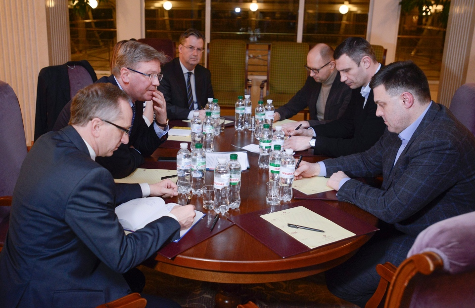 European Commissioner for Enlargement and European Neighborhood Policy Stefan Fule, second left, Ukrainian opposition leaders Arseniy Yatsenyuk, third right, Vitali Klitschko, second right, and Oleh Tyahnybok, right, during their meeting in Kyiv, Ukraine, Tuesday, Feb. 11, 2014. (AP / Andrew Kravchenko)