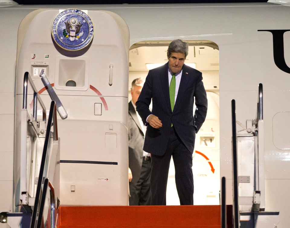 Secretary of State John Kerry steps off his plane after arriving at Halim Air Field on Saturday, Feb. 15, 2014, in Jakarta, Indonesia. (AP / Evan Vucci)