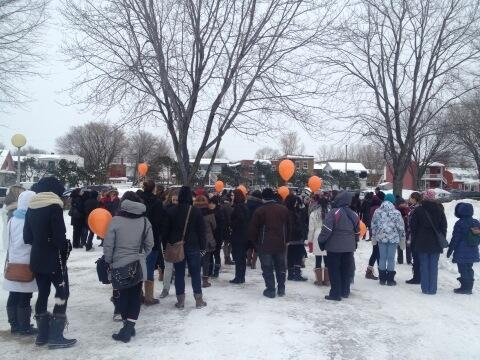 Mourners gather at a school in Trois Rivieres Saturday to remember the three young victims of a triple homicide. (CTV Montreal/Maya Johnson)