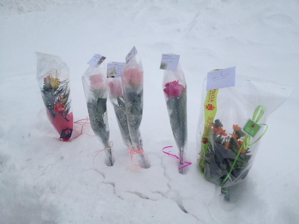 Mourners left flowers at a vigil Saturday for the victims of the February 2014 triple murder in Trois Rivieres. (CTV Montreal/Maya Johnson)