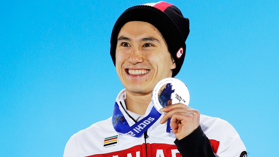 Men's free skate figure skating silver medalist Canada's Patrick Chan smiles during the medals ceremony at the 2014 Winter Olympics, in Sochi, Russia, Saturday, Feb. 15, 2014. (AP / David J. Phillip )