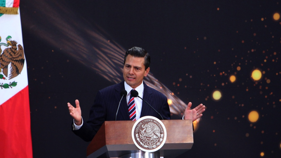 Mexico's President Enrique Pena Nieto speaks during the presentation of the FIFA World Cup soccer trophy in Mexico City, Tuesday, Feb. 11, 2014. (AP / Marco Ugarte)