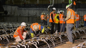 Crews pour concrete to lay the foundation for the New Wilshire Grand building in a record attempt for the largest continuous concrete pour in history, Saturday, Feb. 15, 2014, in downtown Los Angeles. (AP Photo/Mark J. Terrill)