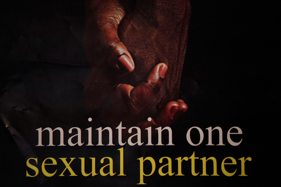 A poster with two hands held together with inscription 'Maintain one sexual partner' is seen in an office in Lagos, Nigeria, Tuesday, Jan. 14, 2014. (AP / Sunday Alamba)