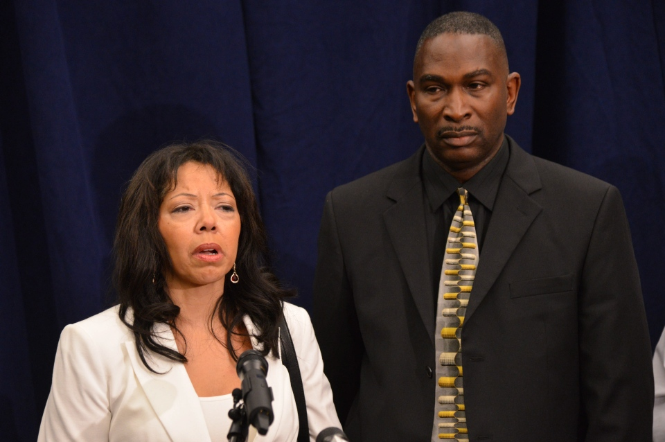Jordan Davis' parents, Lucia McBath, left, and Ronald Davis, speak to the media after the verdict was read in the trial of Michael Dunn, Saturday, Feb. 15, 2014, in Jacksonville, Fla. (AP Photo/The Florida Times-Union, Pool)