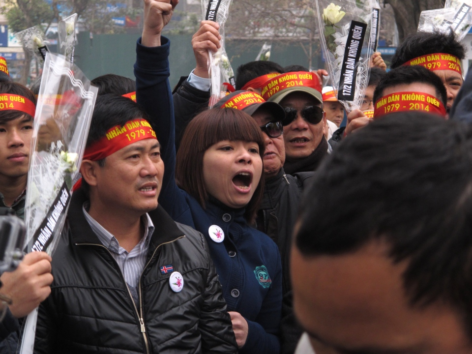 Anti-China protestors rally in the Vietnamese capital Sunday, Feb. 16, 2014 to mark the 35th anniversary of a border war between Vietnam and China. (AP Photo/Chris Brummitt)