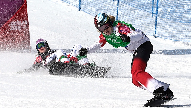Canada's Dominique Maltais at the 2014 Winter Olympics, Sunday, Feb. 16, 2014, in Krasnaya Polyana, Russia. At left is Italy's Michela Moioli. (AP Photo/Andy Wong)