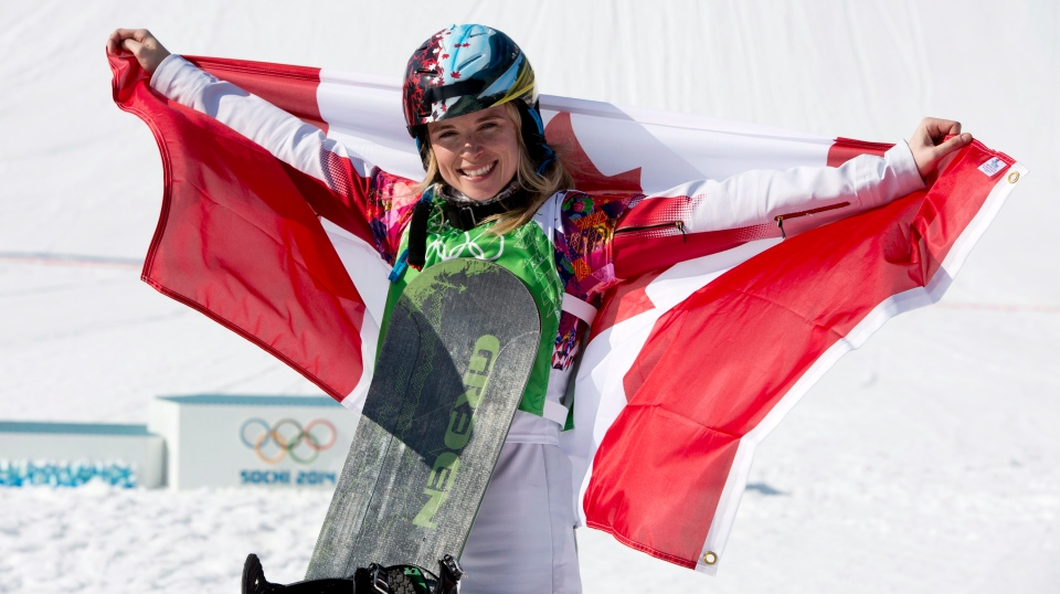 Canada's Dominique Maltais celebrates her silver medal win following the Ladies Snowboard Cross final at the Sochi Winter Olympics in Krasnaya Polyana, Russia, Sunday, Feb. 16, 2014. THE CANADIAN PRESS/Jonathan Hayward