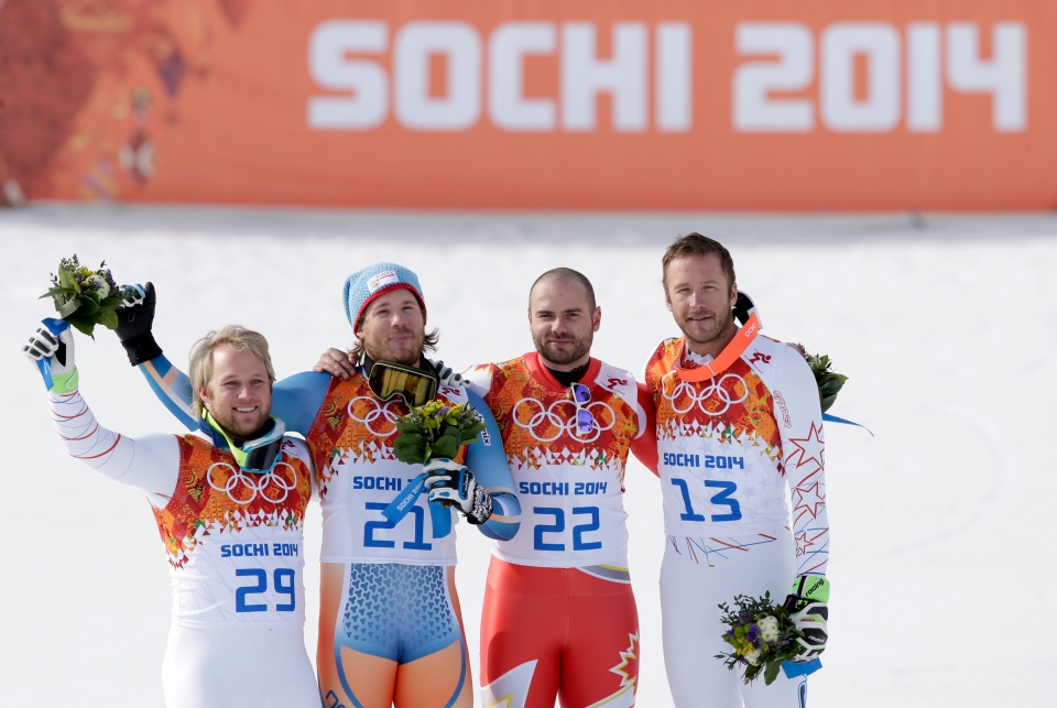 Men's super-G medalists from left, United States' Andrew Weibrecht (silver), Norway's Kjetil Jansrud (gold), Canada's Jan Hudec (bronze) and United States' Bode Miller (bronze) stand on the podium for a flower ceremony at the Sochi 2014 Winter Olympics in Krasnaya Polyana, Russia, Sunday, Feb. 16, 2014. (AP / Gero Breloer)
