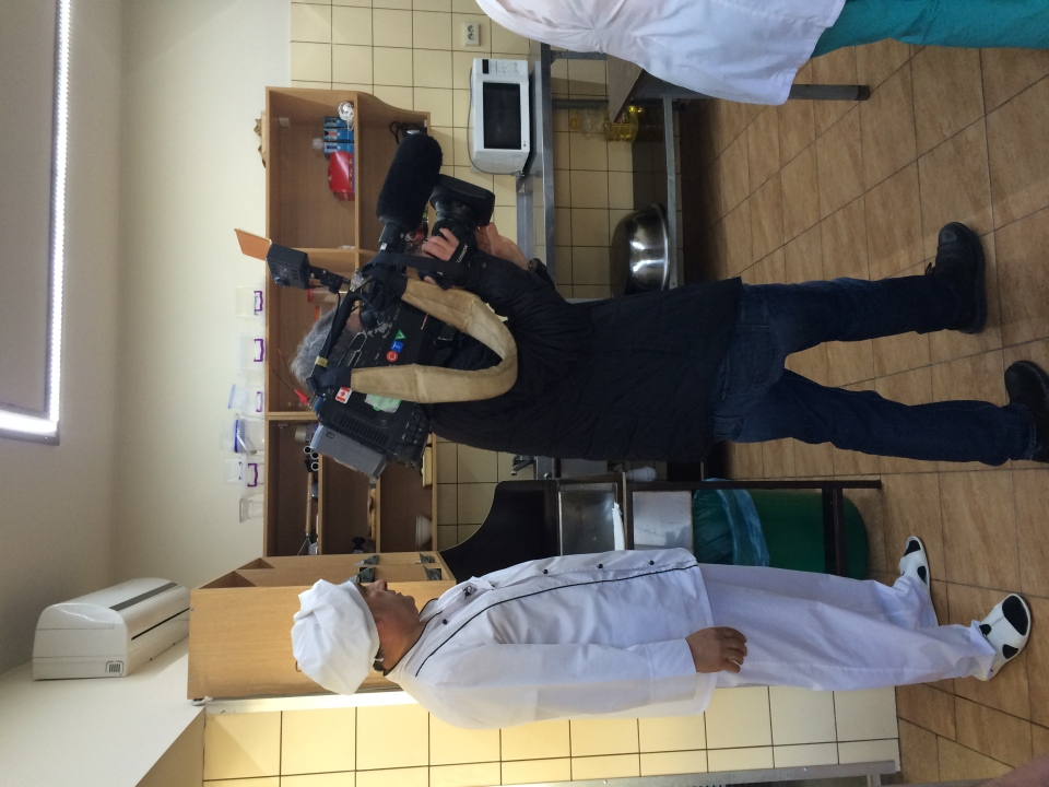 Russian baker Vladimir Markarian is shown, alongside a CTV videojournalist, in his Sochi shop.