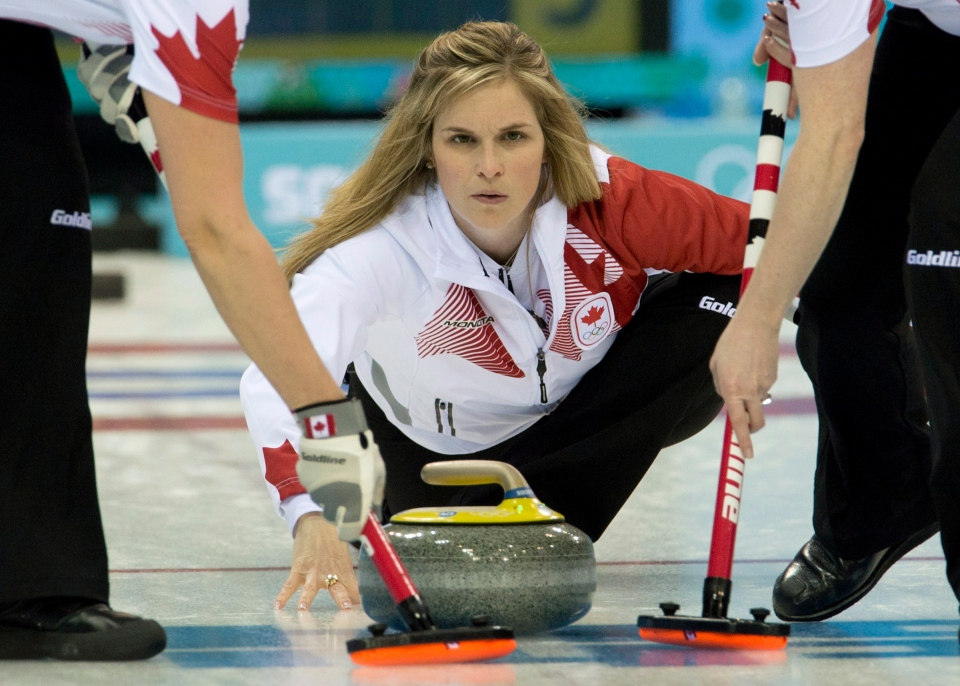 Team Canada skip Jennifer Jones throws a rock during round robin competition against Team USA at the Sochi Winter Olympics Sunday February 16, 2014 in Sochi, Russia. (Adrian Wyld / THE CANADIAN PRESS)