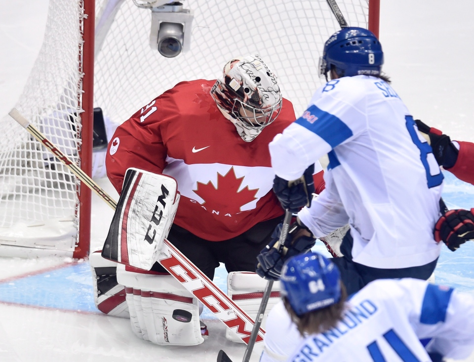 Finland's Teemu Selanne drives to the net on Canada's Carey Price during third period preliminary round hockey action at the 2014 Sochi Winter Olympics in Sochi, Russia on Sunday, Feb. 16, 2014. (Nathan Denette / THE CANADIAN PRESS)