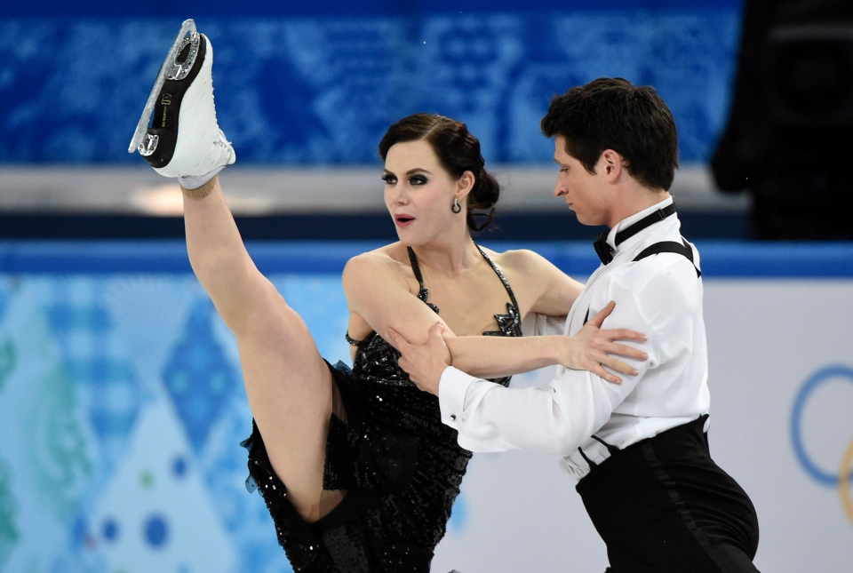 Canada's Tessa Virtue and Scott Moir perform their short dance in the ice dance competition at the Sochi Winter Olympics Sunday, February 16, 2014 in Sochi. (Paul Chaisson / THE CANADIAN PRESS)