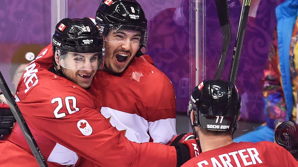 Canada defenceman Drew Doughty, centre, celebrates with teammates John Tavares (20) and Jeff Carter (77) after scoring the game-winning goal in overtime against Finland during preliminary round hockey action at the 2014 Sochi Winter Olympics in Sochi, Russia on Sunday, Feb. 16, 2014. (Nathan Denette / THE CANADIAN PRESS)