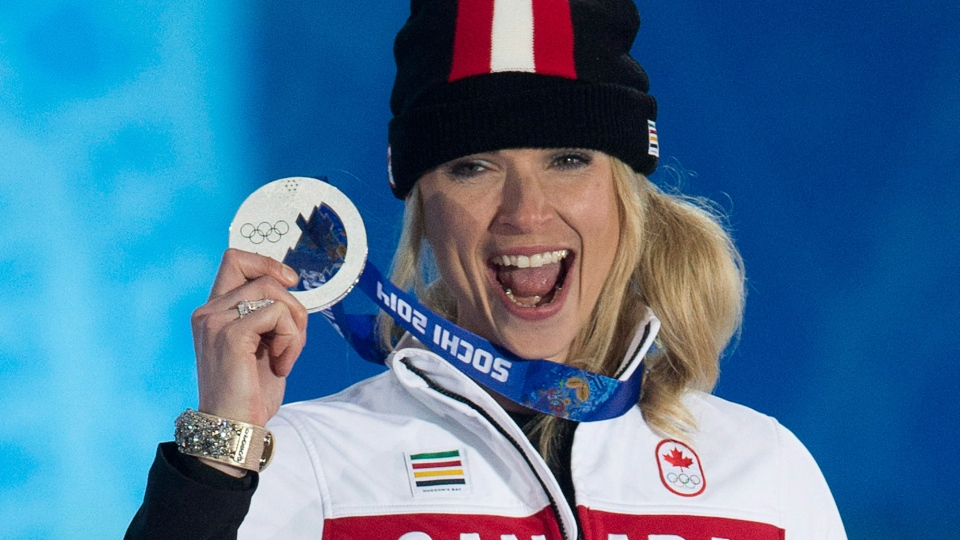 Canada's Dominique Maltais holds up her silver medal for Ladies' Snowboard-Cross during the medal ceremony at the Sochi Winter Olympics in Sochi, Russia, Sunday, Feb. 16, 2014. (Adrian Wyld / THE CANADIAN PRESS)