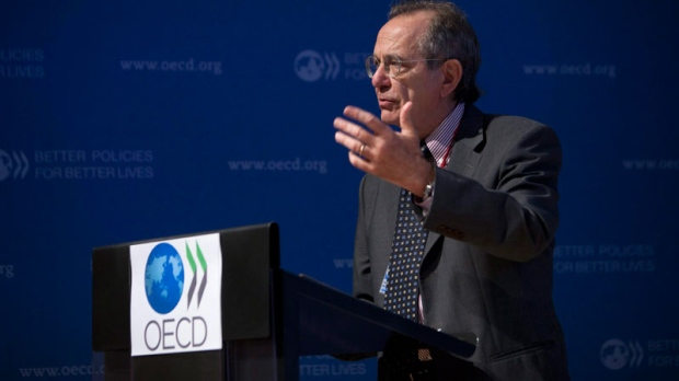 OECD Chief Economist, Pier Carlo Padoan, gestures during a press conference held at the OECD headquarters in Paris, France, Thursday Sept. 8, 2011. (AP / Thibault Camus)