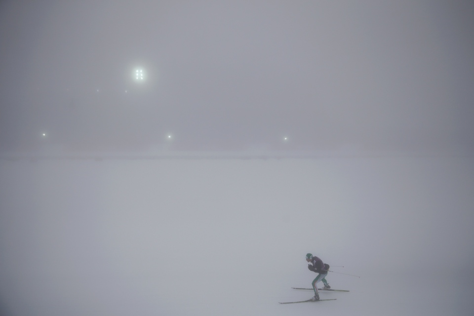 An athlete trains in heavy fog at the cross-country stadium in Krasnaya Polyana, Russia, during the 2014 Winter Olympics, Monday, Feb. 17, 2014. (AP  / Jae C. Hong)