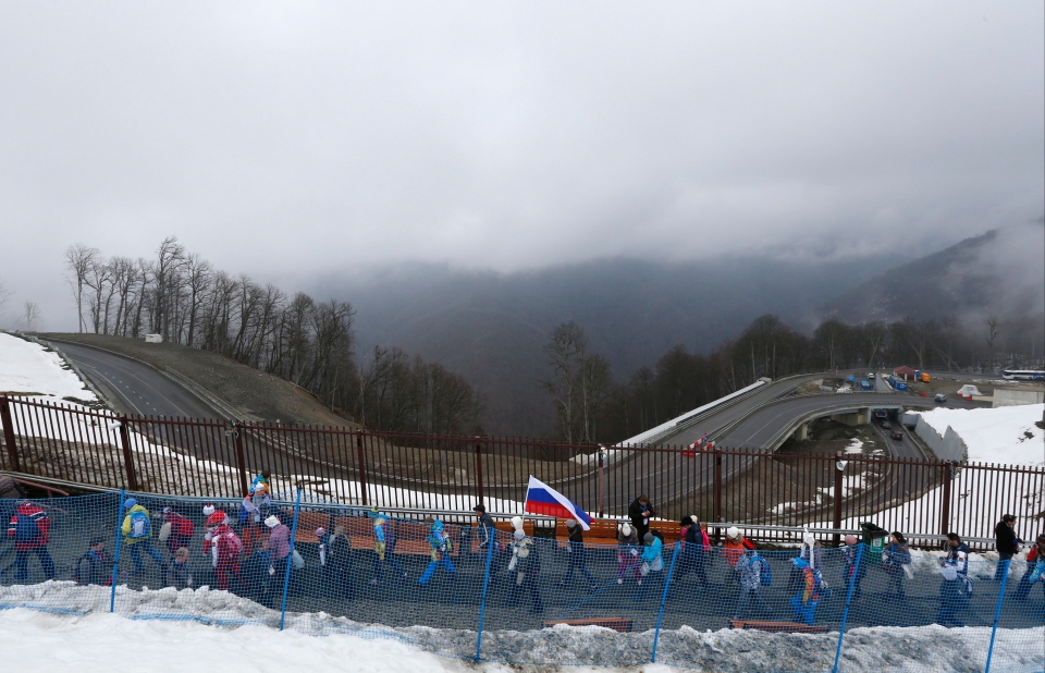 Spectators leave the venue after the men's snowboard cross competition was cancelled due to fog at the Rosa Khutor Extreme Park, at the 2014 Winter Olympics in Krasnaya Polyana, Russia, Monday, Feb. 17, 2014. (AP / Sergei Grits)