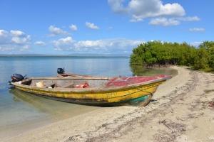 A fishing boat rests on a sandy beach of uninhabited Little Goat Island, Jamaica on Jan. 25, 2014. (AP / David McFadden)