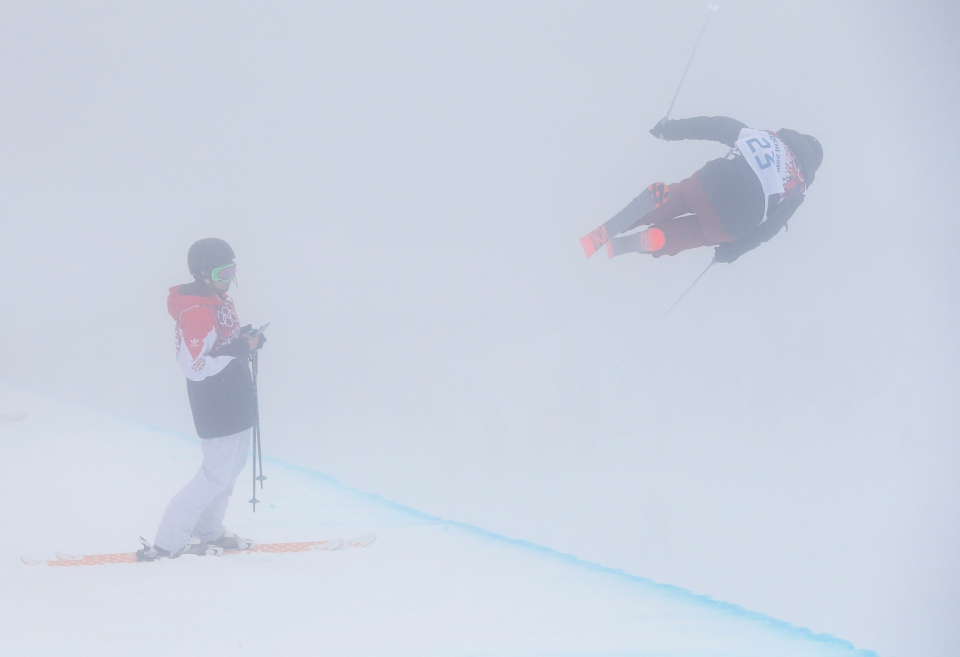 Athletes train in the fog during a freestyle skiing training session in the halfpipe of the Rosa Khutor Extreme Park, at the 2014 Winter Olympics, Monday, Feb. 17, 2014, in Krasnaya Polyana, Russia. (AP / Sergei Grits)