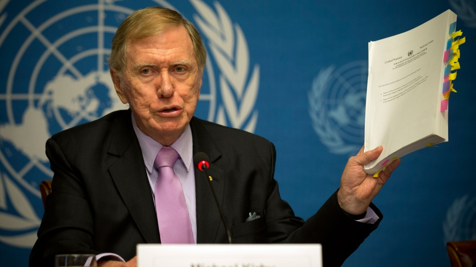 Retired Australian judge Michael Kirby, chairperson of the commission of Inquiry on Human Rights in the Democratic People's Republic of Korea, shows the commission's report during a press conference at the United Nations in Geneva, Switzerland, Monday, Feb. 17, 2014. (AP / Anja Niedringhaus)
