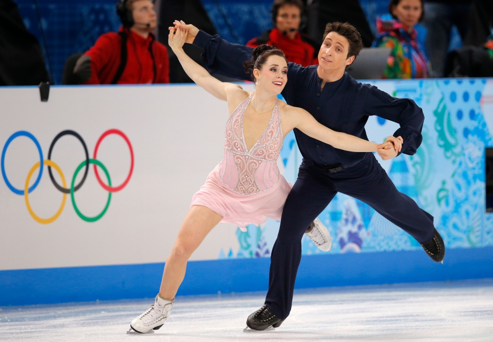 Tessa Virtue and Scott Moir of Canada compete in the ice dance free dance figure skating finals at the Iceberg Skating Palace during the 2014 Winter Olympics in Sochi, Russia, Monday, Feb. 17, 2014. (AP / Vadim Ghirda)