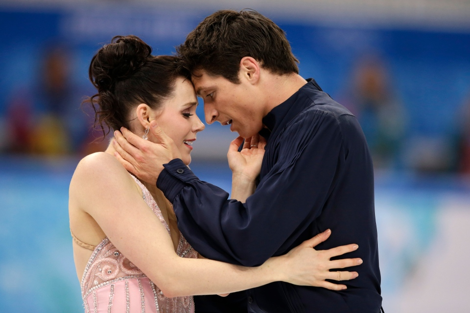 Tessa Virtue and Scott Moir of Canada compete in the ice dance free dance figure skating finals at the Iceberg Skating Palace during the 2014 Winter Olympics, Monday, Feb. 17, 2014, in Sochi, Russia. (AP / Darron Cummings)