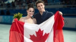 Ice dance silver medallists Canada's Tessa Virtue and Scott Moir pose with the Canadian flag during flowers ceremony at the Sochi Winter Olympics Monday, Feb, 17, 2014 in Sochi. (Paul Chiasson / THE CANADIAN PRESS)