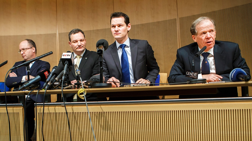 Robert Deillon, right, General Director of the Geneva Airport, is sitting next to Olivier Jornot, left, Prosecutor General of Canton of Geneva, Eric Grandjean, second left, spokesperson of the Geneva police, and Pierre Maudet, second right, Councillor of the Geneva State, as he answers questions to reporters about a hijacked Ethiopian Airlines Plane, during a press conference, in Geneva, Switzerland, Monday, Feb.17, 2014. (Keystone, Salvatore Di Nolfi)