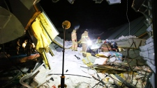 Rescue workers search for survivors in South Korea