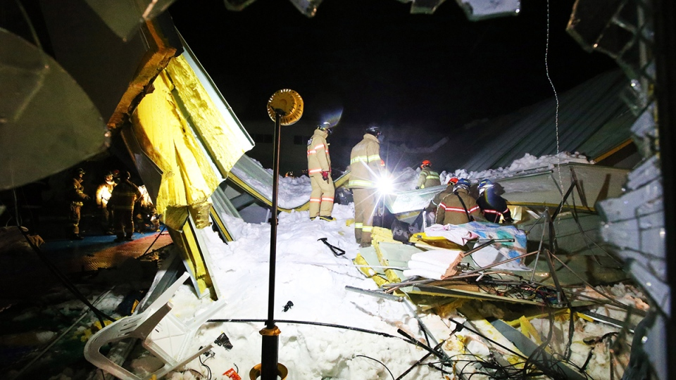 Rescue workers search for survivors from a collapsed resort building in Gyeongju, South Korea, Monday, Feb. 17, 2014. (AP / Yonhap, Lee Jae-hyuck)