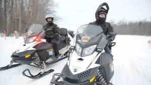 The Huron County OPP released this image of Const. Scott Mead, left, and Const. Gentry Wilson, two of the region's trained snowmobile operators, out on the trails.