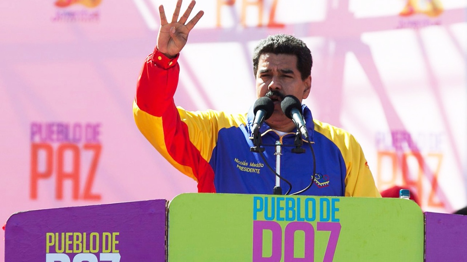 Venezuela's President Nicolas Maduro speaks during a rally on Bolivar Avenue in downtown Caracas, Venezuela, Saturday, Feb. 15, 2014. (AP / Alejandro Cegarra)