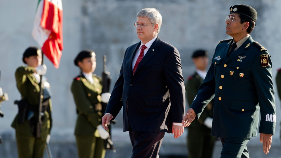 Prime Minister Stephen Harper reviews the honor guard after a wreath-laying ceremony at the Ninos Heroes monument, or Children Heroes, in Mexico City, Monday, Feb. 17, 2014. (AP / Eduardo Verdugo)