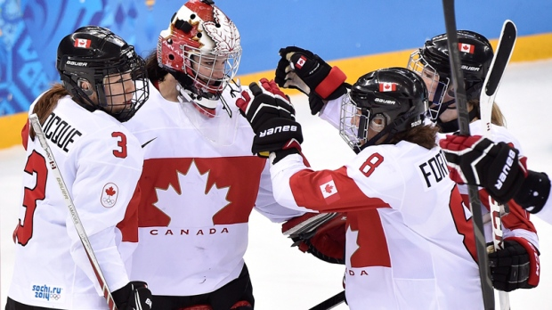 Team Canada celebrates in Sochi, Feb. 17, 2014