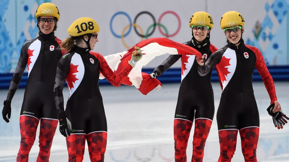 Members of the Canadian team celebrate tehir silver medal victory in the 3,000 metre relay final at the Sochi Winter Olympics in Sochi, Tuesday, Feb. 18, 2014. (Paul Chiasson / THE CANADIAN PRESS)