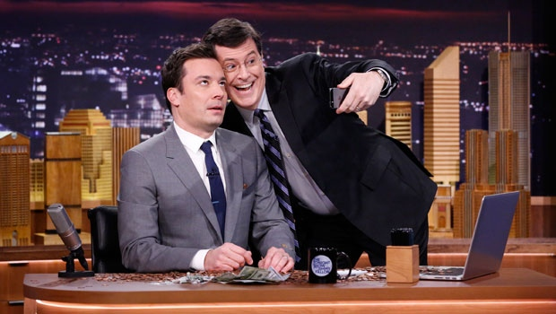 "In this photo provided by NBC, Jimmy Fallon appears with Stephen Colbert, right, during his ""The Tonight Show"" debut on Monday, Feb. 17, 2014, in New York. (AP Photo/NBC, Lloyd Bishop)"
