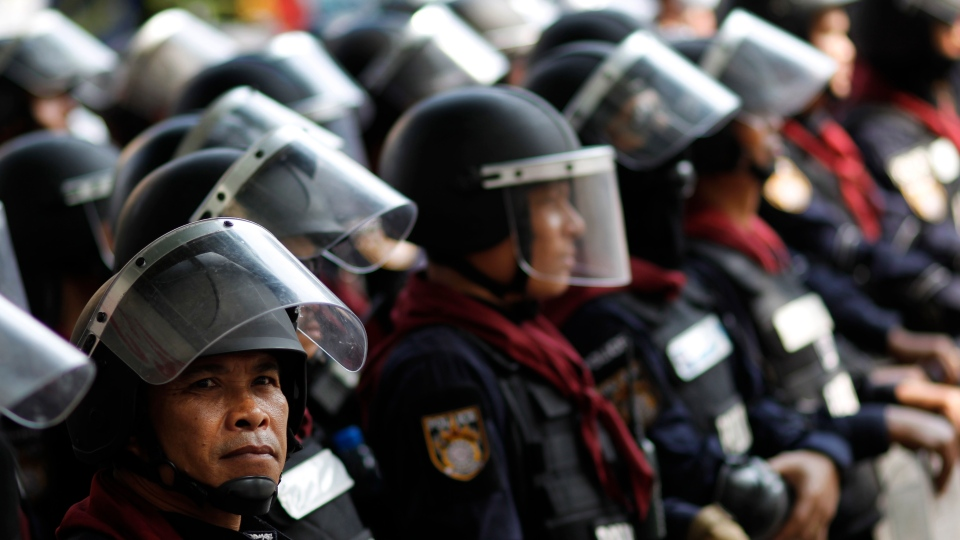 Riot police hold a line during a stand-off with anti-government protesters in Bangkok, Thailand, Tuesday, Feb. 18, 2014. (AP / Wally Santana)