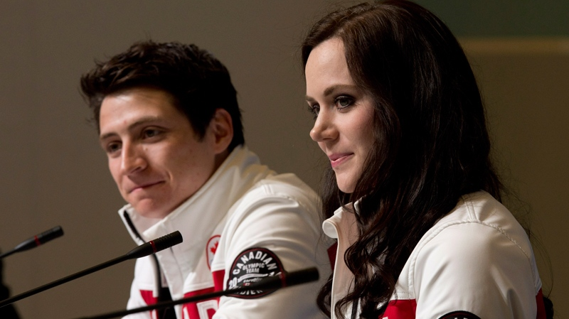 Canada's Scott Moir and Tessa Virtue listen to a question during a news conference at the Sochi Winter Olympics Tuesday, Feb. 18, 2014. (Adrian Wyld / THE CANADIAN PRESS)